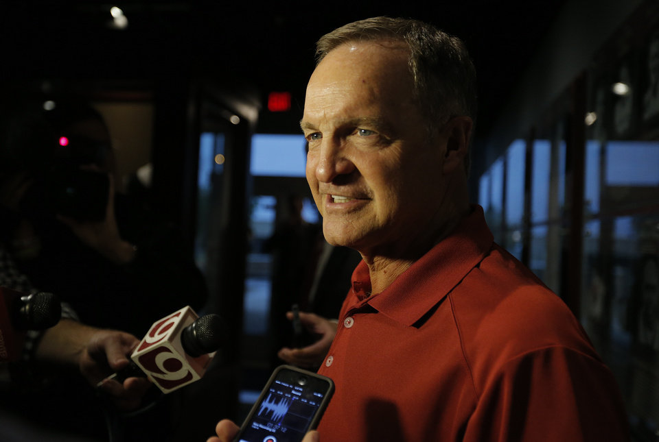 Photo - University of Oklahoma men's basketball coach Lon Kruger talks to the media during the Sooner Caravan at the Jim Thorpe Museum in Oklahoma City, Okla. on Wednesday, July 30, 2014.  Photo by Chris Landsberger, The Oklahoman