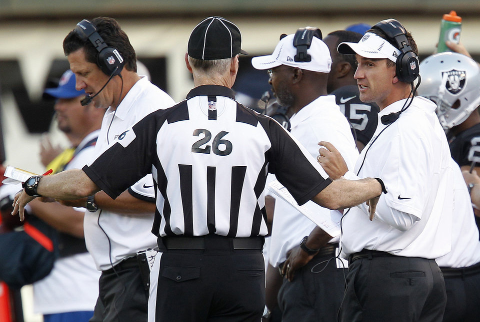 Photo -   Oakland Raiders head coach Dennis Allen, right, talk with an official during the third quarter of an NFL preseason football game against the Dallas Cowboys in Oakland, Calif., Monday, Aug. 13, 2012. (AP Photo/Tony Avelar)