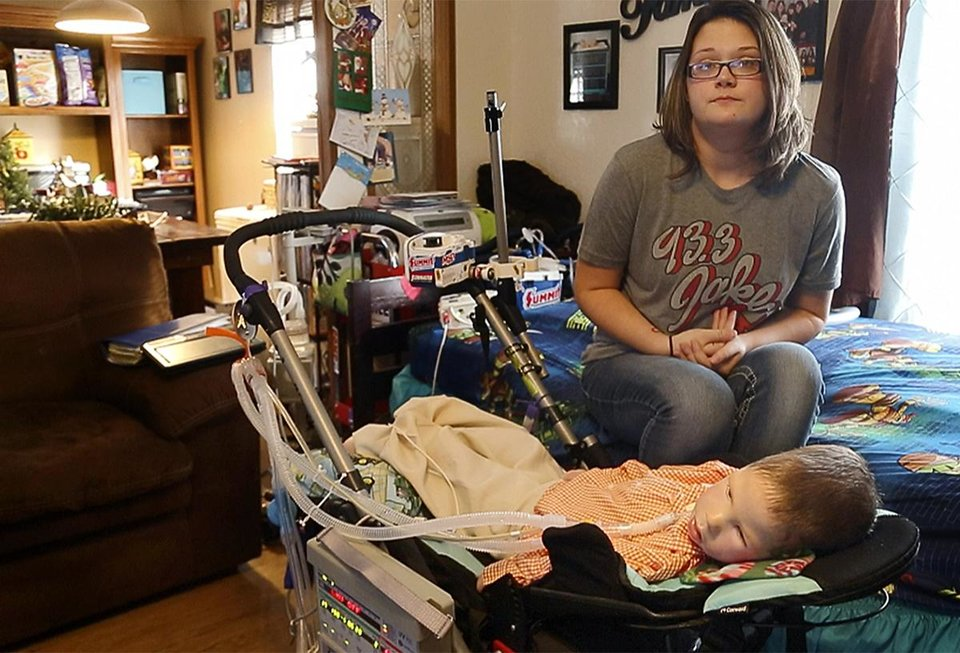 Photo - Amanda Chaffin sits with her son Kayden at their home in Noble, Okla., Tuesday, Dec. 6, 2016. Chaffin has spinal muscular atrophy, a genetic illness and his family collects Christmas cards for him. Photo by Sarah Phipps, The Oklahoman