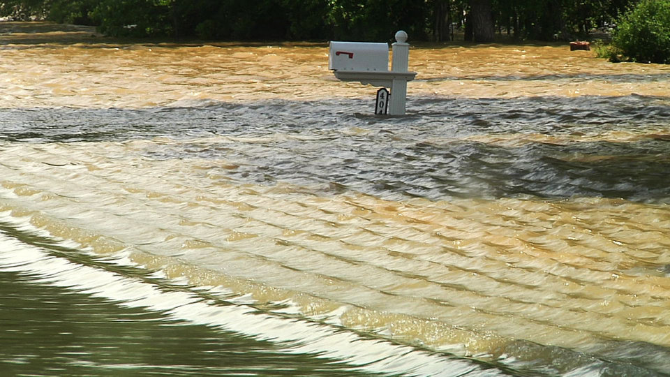 Photo - This photo taken from video shows a mailbox nearly under water in a neighborhood in Poplar Bluff, Mo., Wednesday, April 27, 2011, from floodwaters from the Black River. (AP Photo/Robert Ray)