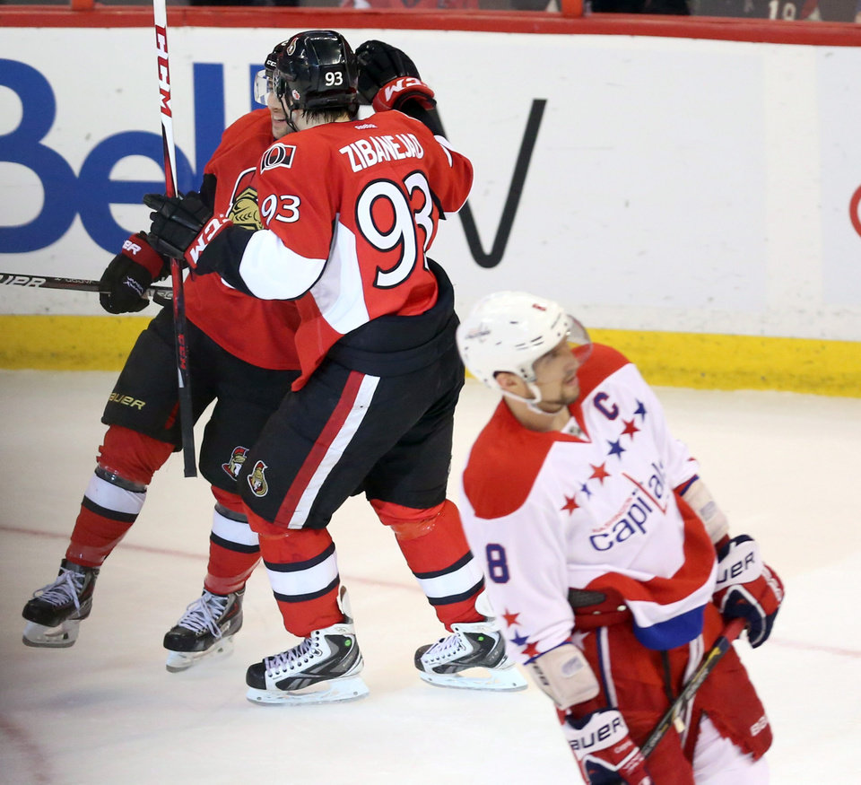 Photo - Ottawa Senators' Cory Conancher (89) and Mika Zibanjed (93) celebrate Conancher's goal as Washington Capitals' Alex Ovechkin (8) skates away during the second period of an NHL hockey game in Ottawa, Ontario on Thursday April 18, 2013. (AP Photo/The Canadian Press, Fred Chartrand)