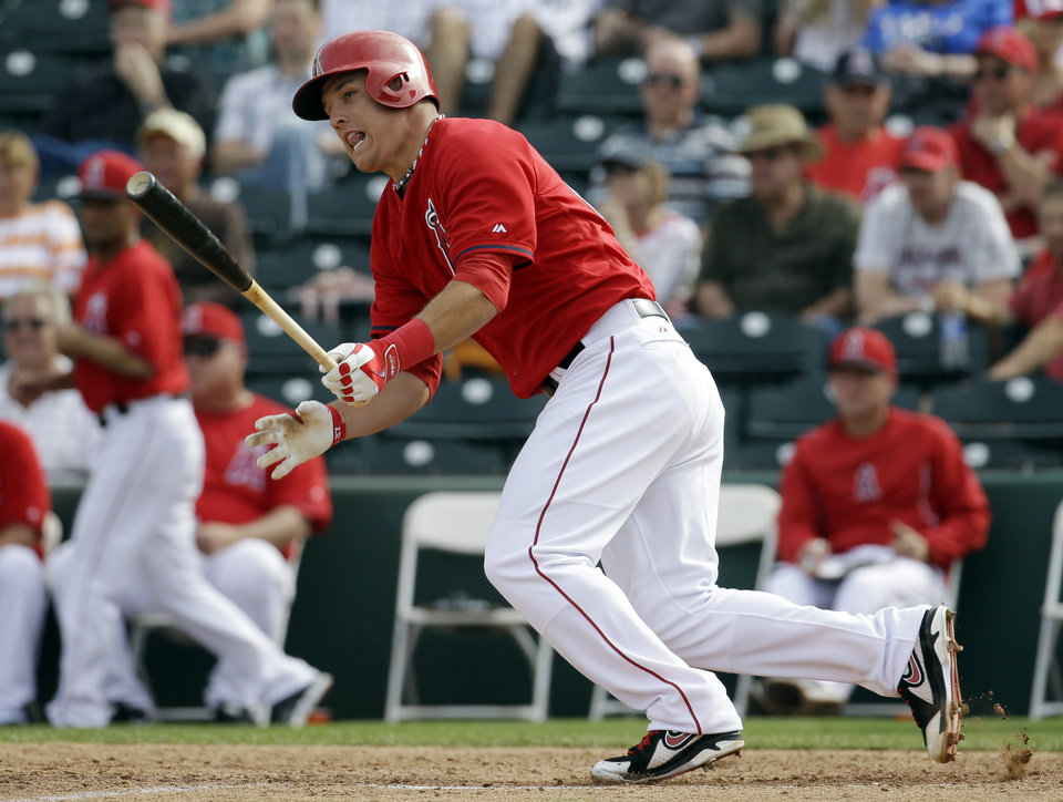 Photo - Los Angeles Angels' Mike Trout hits a single during the sixth inning of an exhibition spring training baseball game against the Texas Rangers Tuesday, March 4, 2014, in Tempe, Ariz. (AP Photo/Morry Gash)
