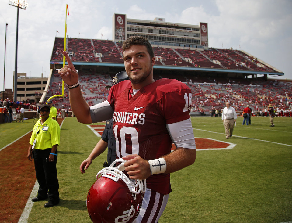 Photo - Oklahoma's Blake Bell (10) acknowledges the crowd after a college football game between the University of Oklahoma Sooners (OU) and the Tulsa Golden Hurricane at Gaylord Family-Oklahoma Memorial Stadium in Norman, Okla., on Saturday, Sept. 14, 2013. Oklahoma won 51-20. Photo by Bryan Terry, The Oklahoman