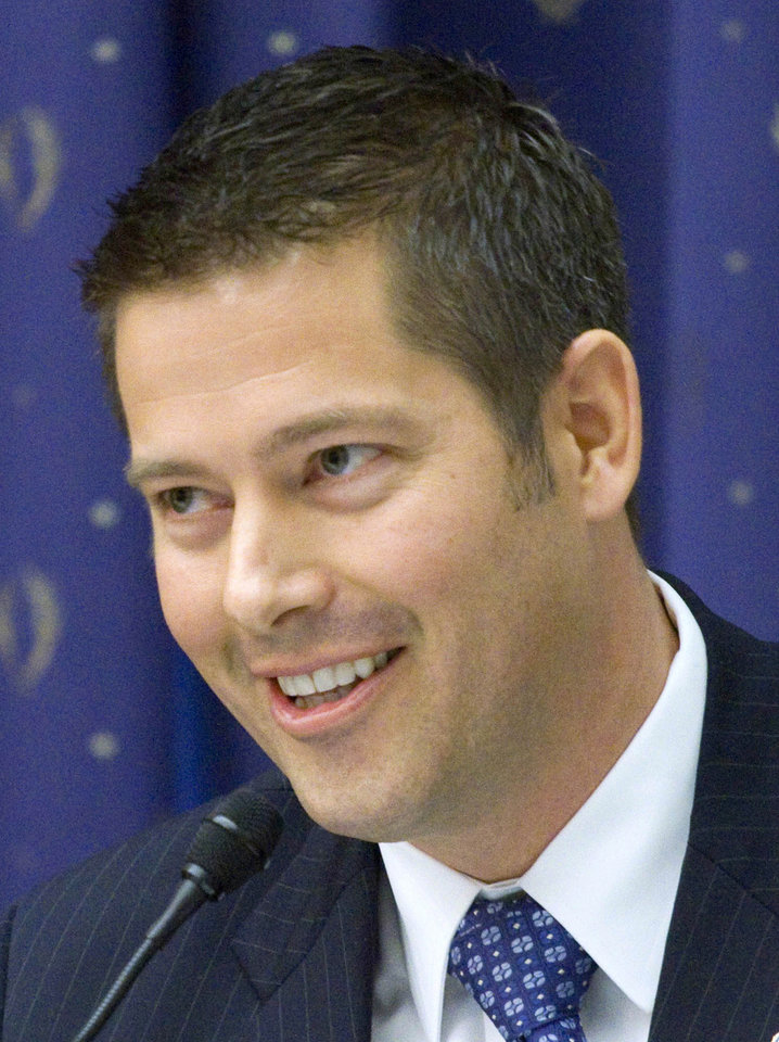 Photo - FILE - In this March 16, 2011 file photo, Rep. Sean Duffy, R-Wis. takes part in a hearing on Capitol Hill in Washington. Duffy's office said in an email Thursday, Oct. 3, 2013, that the Republican was walking toward the Capitol to vote on legislation when someone he didn't know began screaming at him and grabbed his arm. The office said Duffy was not harmed but reported the incident to police as required by U.S. House security procedures.  (AP Photo/Harry Hamburg, File)