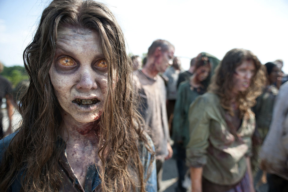 """Photo - In this image released by AMC, zombies appear in a scene from the second season of the AMC original series, """"The Walking Dead,"""" in Senoia, Ga. The seriesÂ' fourth season premieres on Oct. 13. Crews have been filming the new episodes in Georgia, but they keep locations of future episodes closely-guarded secrets until the shows air.  In Grantville, Ga., the townÂ's ruins were featured prominently last season.   In nearby Senoia, many scenes are filmed in the historic downtown area, transforming into the fictional town of Woodbury for the show.   (AP Photo/AMC, Gene Page)  NO SALES  ORG XMIT: GADG302"""