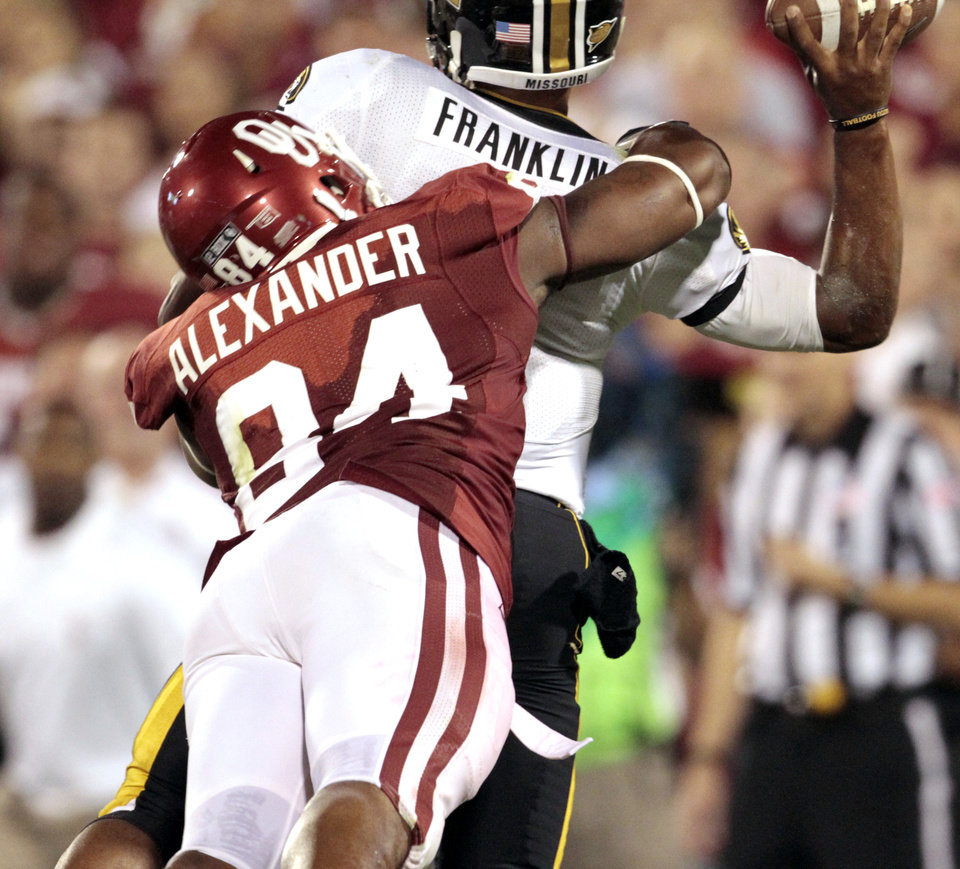 Oklahoma\'s Frank Alexander sacks Missouri quarterback James Franklin during their game Saturday in Norman. Photo by Steve Sisney, The Oklahoman