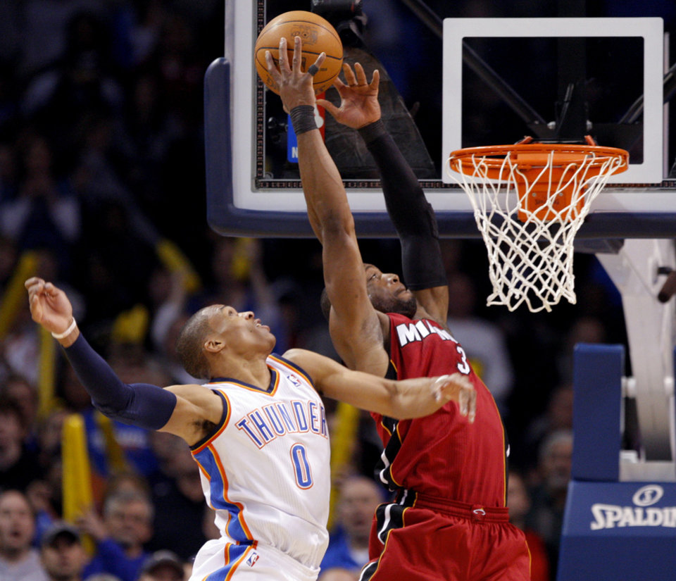 Photo - Miami's Dwyane Wade (3) shoots as Oklahoma City's Russell Westbrook (0) defends during the NBA basketball game between Oklahoma City and Miami at the OKC Arena in Oklahoma City, Thursday, Jan. 30, 2011. Photo by Sarah Phipps, The Oklahoman