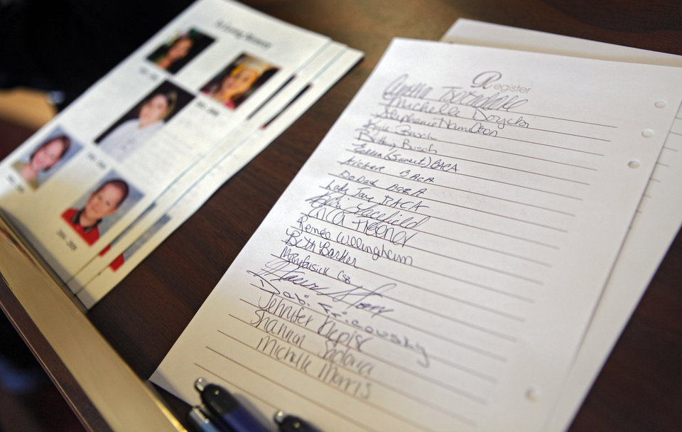 Names of Friends and family fill the guest register for funeral services for Summer Rust and her four children Kirsten Rust, Autumn Rust, Teagin Rust and Evynn Garas in El Reno, Okla. on Wednesday, Jan. 21, 2009. Rust and her children were killed earlier this month in their apartment in El Reno, Okla. 