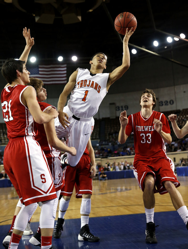 Photo - Douglass' Antonio Wilson shoots as the Stilwell Indians play the Douglass Trojans in the finals of the State Class 4A Boys Basketball Tournament at the Fairgrounds Arena on Saturday, March 15, 2014, in Oklahoma City, Okla. Photo by Steve Sisney, The Oklahoman