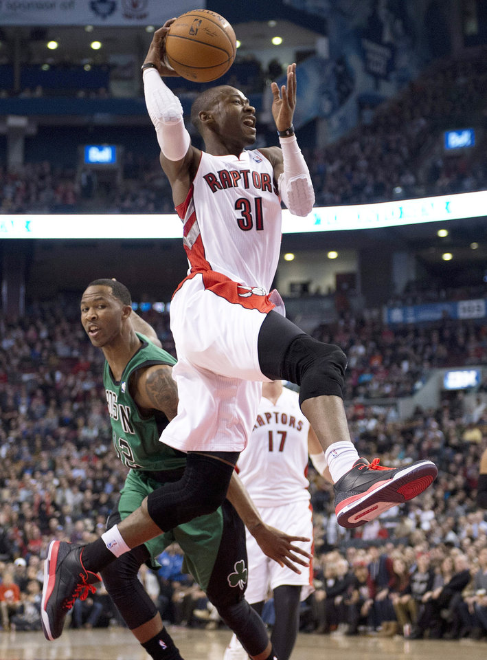 Photo - Toronto Raptors guard Terrence Ross (31) is fouled by Boston Celtics guard Chris Johnson (back) on his way to the hoop during first half NBA action in Toronto on Friday March 28, 2014. (AP Photo/The Canadian Press,Frank Gunn)
