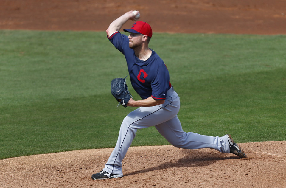 Photo - Cleveland Indians pitcher Corey Kluber throws against the Cincinnati Reds in the second inning of an exhibition baseball game in Goodyear, Ariz., Thursday, Feb. 27, 2014. (AP Photo/Paul Sancya)
