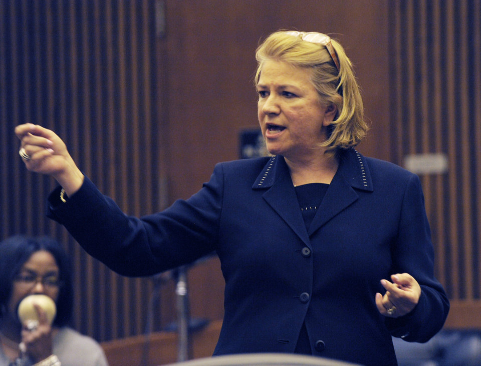 Photo - Asst. Prosecutor, Athina Siringas speaks during closing arguments in the Theodore Wafer case Wednesday, Aug. 6, 2014, in Detroit. The case of Wafer, a suburban Detroit homeowner who opened his front door and blasted an unarmed woman on his porch, has gone to the jury. Wafer is charged with second-degree murder and manslaughter in the death of 19-year-old Renisha McBride. (AP Photo/Detroit News, Clarence Tabb Jr.)