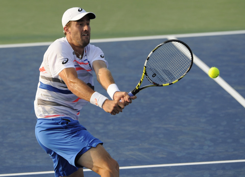 Photo - Steve Johnson hits the ball against John Isner during a match at the Citi Open tennis tournament, Wednesday, July 30, 2014, in Washington. (AP Photo/Nick Wass)