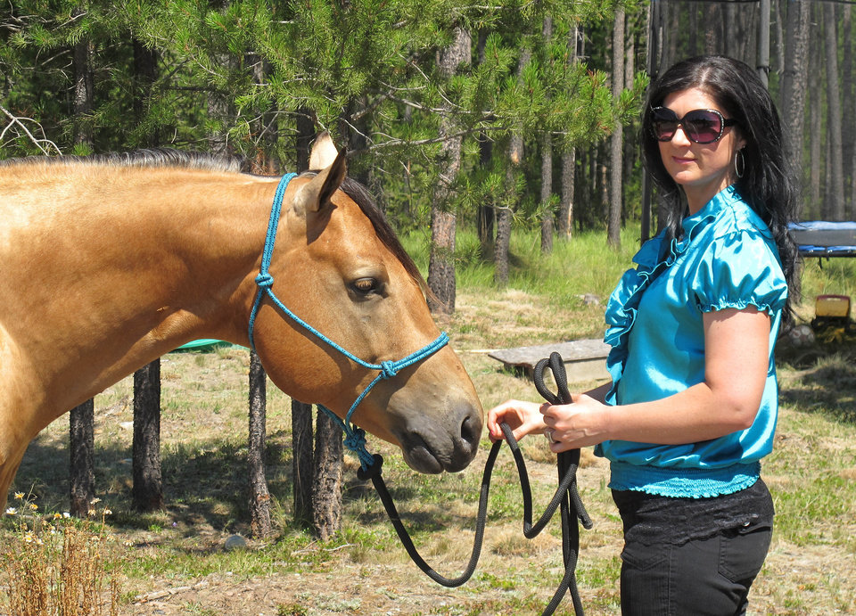 Photo -   This photo taken Aug. 7, 2012 shows Sara Weaver at her horse at her ranch outside Kalispell, Mont. Weaver has finally forgiven the federal agents who 20 years ago shot her mother and younger brother to death during the siege at Idaho's Ruby Ridge. (AP Photo/Nicholas K. Geranios)