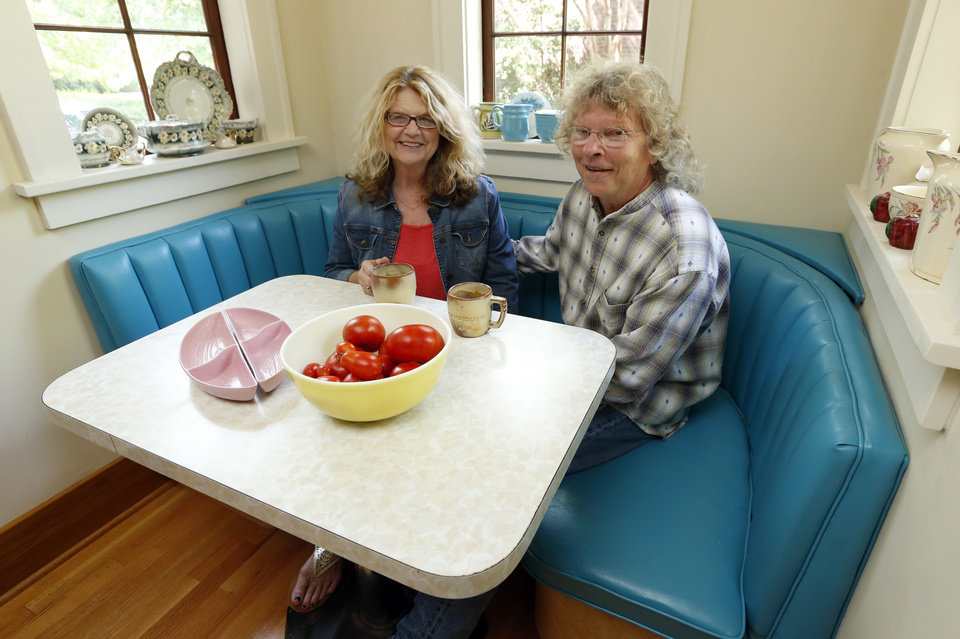 Photo - Michael Brinkley and Lynda Donley in the breakfast dining area of their home at 639 S Lahoma in Norman.  STEVE SISNEY -  THE OKLAHOMAN