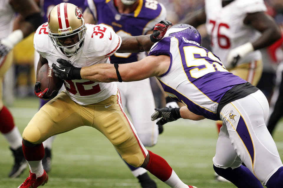 Photo -   San Francisco 49ers running back Kendall Hunter (32) tries to break a tackle by Minnesota Vikings outside linebacker Chad Greenway, right, during the first half of an NFL football game, Sunday, Sept. 23, 2012, in Minneapolis. (AP Photo/Genevieve Ross)