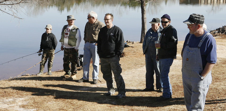 A crowd gathers to watch 660 rainbow trout being stocked into Dolese Youth Lake, NW 50 and Meridian, in Oklahoma City Thursday, Jan. 8, 2009, during the second stocking for trout season at the lake. The trout season runs until Feb. 28 with stockings every two weeks. BY PAUL B. SOUTHERLAND, THE OKLAHOMAN