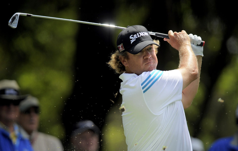 Photo - William McGirt watches his drive off the ninth tee during the first round of the RBC Heritage golf tournament in Hilton Head Island, S.C., Thursday, April 17, 2014. (AP Photo/Stephen B. Morton)