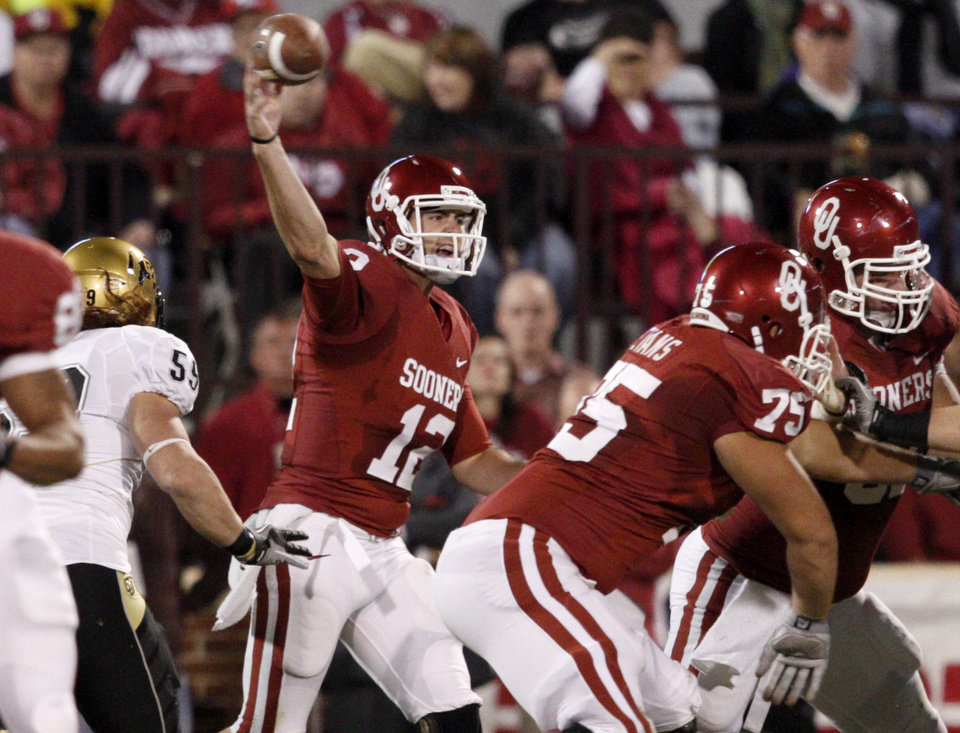 Photo - OU's Landry Jones throws a pass during the college football game between the University of Oklahoma (OU) Sooners and the University of Colorado Buffaloes at Gaylord Family-Oklahoma Memorial Stadium in Norman, Okla., Saturday, October 30, 2010. Photo by Bryan Terry, The Oklahoman