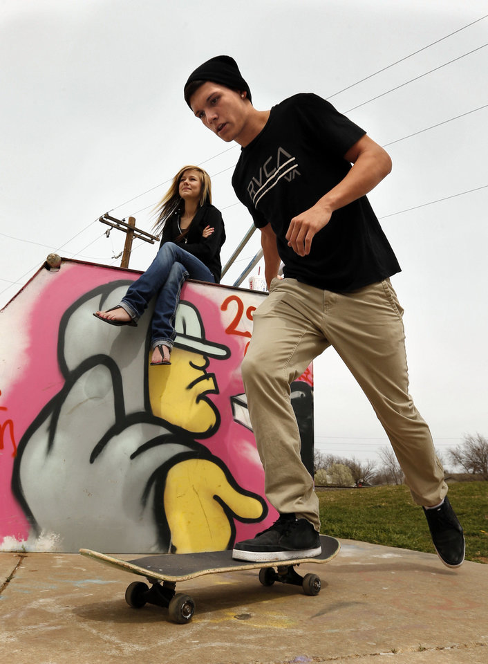 Photo - Above: Coop Watts, 17, and Morgan Stumpf, 16, Little Axe students on spring break, skate Tuesday at Blake Baldwin Skate Park in Norman.  Photos by Steve Sisney,  The Oklahoman