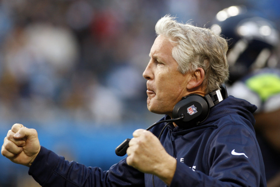 Seattle Seahawks head coach Pete Carroll reacts after a Seahawks touchdown against the Carolina Panthers during the third quarter of an NFL football game in Charlotte, N.C., Sunday, Oct. 7, 2012. (AP Photo/Nell Redmond)