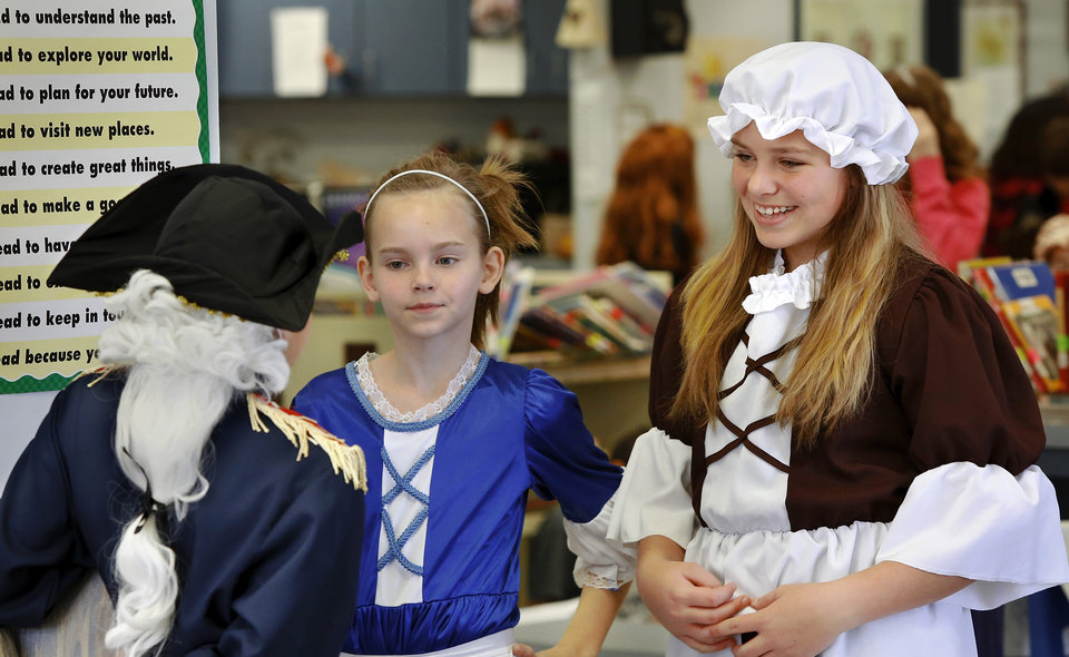 Madison Barron, center, and Abby Boyer  talk to Lane Youngblood at the end of the program. Barron was Dolly Madison; Boyer was Lydia Darragh and Youngblood played the role of General George Washington. Wearing authentic era attire, students in Rhonda Watkins' fourth and fifth grade social studies classes at Schwartz Elementary School portrayed various figures from the American Revolution period during  a living history museum program in the school's library on Wednesday,  Jan. 30,  2013.  The students selected a historical person from a list provided by Watkins, and  were required to research the subject, write a report and make a verbal presentation about the person. All students in the school were invited to the library to hear the characters tell about their lives.   Photo by Jim Beckel, The Oklahoman