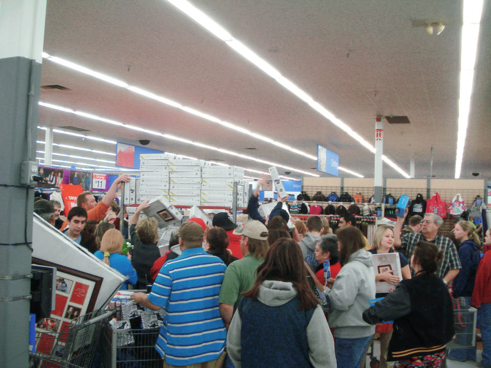 Photo - Elk City Walmart shoppers are shown crowded around electronic items just as 5 a.m. arrived, which meant they could start taking them off the shelves.Photo by Jim Stafford, for the oklahoman