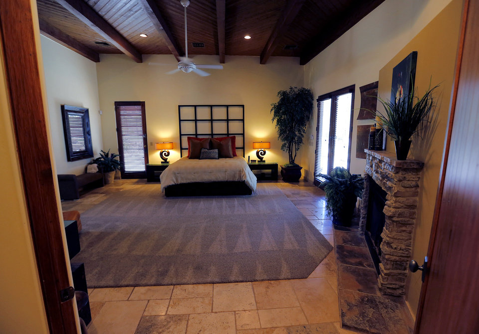 Photo - This is a view of the master suite in a luxury home with a listing price of $1 million on Wednesday, July 30, 2014, in the Las Sendas community of Mesa, Ariz. The more than 4,000-square-foot home has a private suite with its own bath, fireplace and office, as well as a resort style back yard with a pool and hot tub. The home showcases a desert view on a golf course in the Phoenix suburb. (AP Photo/Matt York)