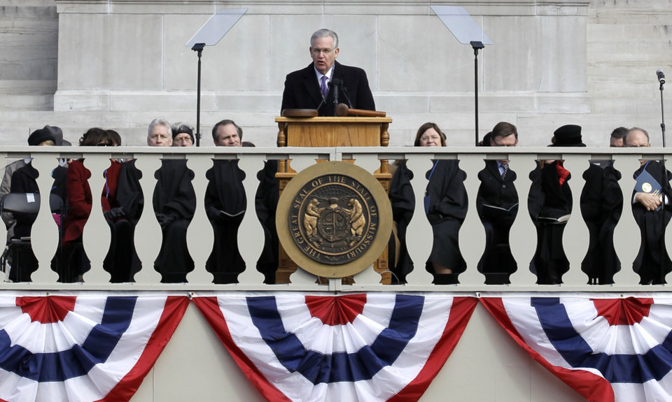 Missouri Gov. Jay Nixon delivers his inaugural address after being sworn in to a second term Monday, Jan. 14, 2013, in Jefferson City, Mo. (AP Photo/Jeff Roberson)