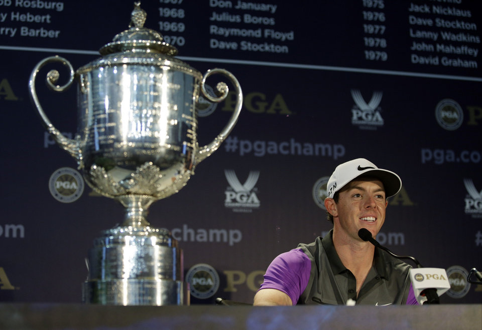 Photo - Rory McIlroy, of Northern Ireland, speaks to the media during a news conference after winning the PGA Championship golf tournament at Valhalla Golf Club on Sunday, Aug. 10, 2014, in Louisville, Ky. (AP Photo/John Locher)