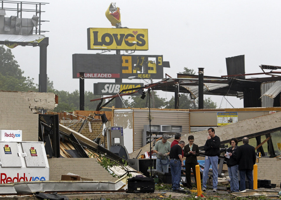 Photo - LOVE'S TRAVEL STOP / STORM DAMAGE / I-40: Employees and members of the media gather at the Love's store to examine tornado damage at Choctaw Road and Interstate 40 east of Oklahoma City on Tuesday, May 11, 2010. (AP Photo/The Dallas Morning News, Louis DeLuca) NO SALES, MAGS OUT, TV OUT, INTERNET: AP MEMBERS ONLY ORG XMIT: TXDAM101