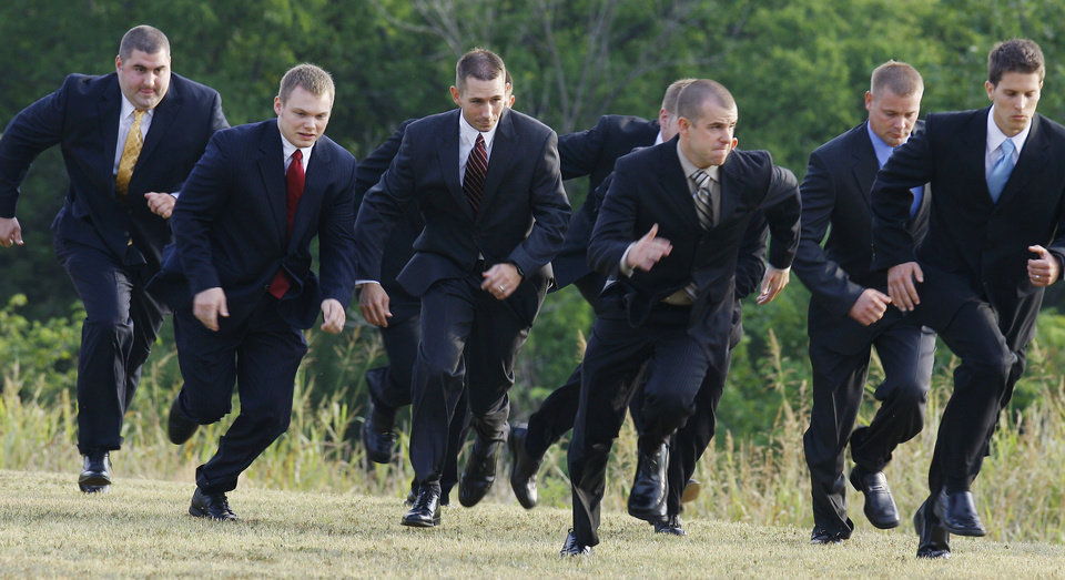 Edmond Police Department cadets run to their first class after morning ceremonies for the first police academy class in Edmond Monday, July 20, 2009. Photo by Paul B. Southerland, The Oklahoman