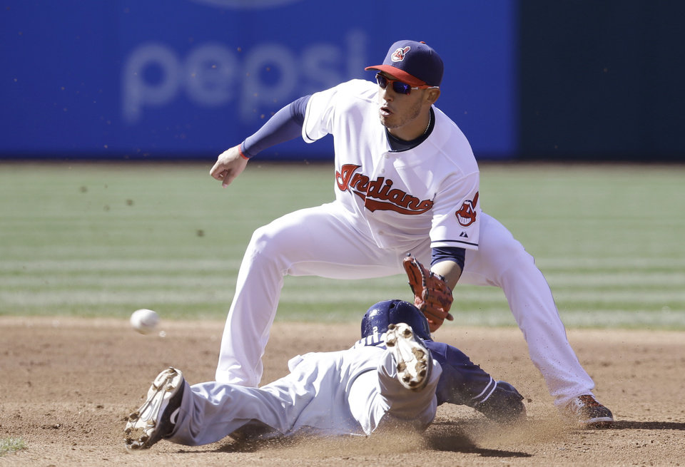 Photo - San Diego Padres' Everth Cabrera, bottom, slides safely into second base as Cleveland Indians' Asdrubal Cabrera waits for the ball during the third inning in the second game of a baseball doubleheader on Wednesday, April 9, 2014, in Cleveland.  (AP Photo/Tony Dejak)