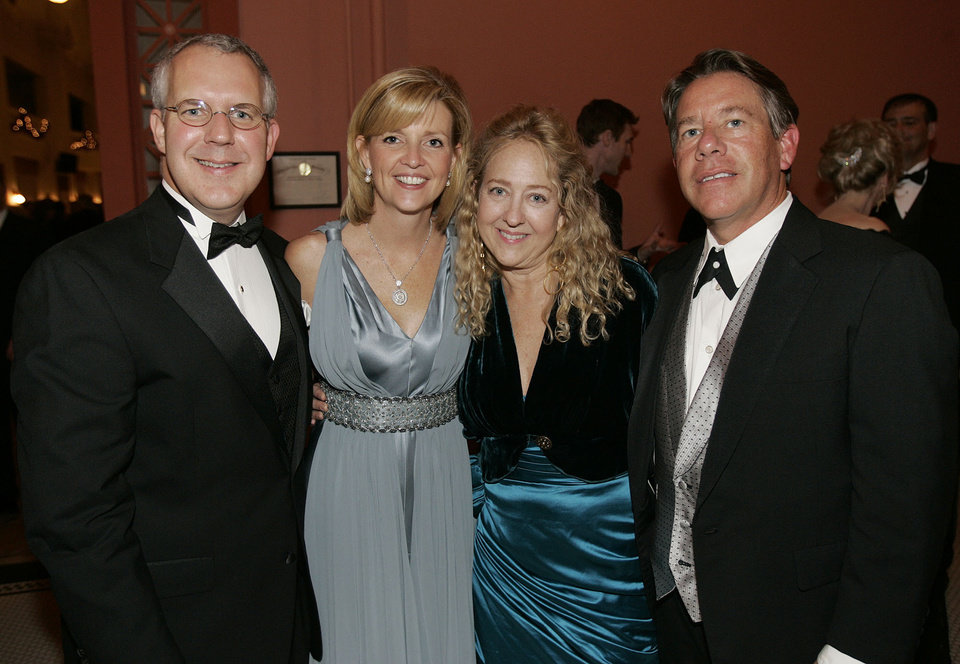 Photo - Oklahoma Gov. Brad Henry, left, his wife, Kim, pose for a photo with Jenny and Rick Dunning of Oklahoma City, at the Oklahoma Centennial Statehood Inaugural Ball, Saturday, Nov. 17, 2007, at the Guthrie Scottish Rite Masonic Center, in Guthrie, Okla. By Bill Waugh, The Oklahoman