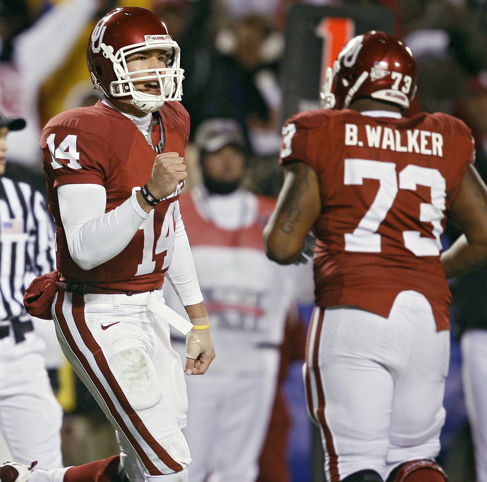 For at least one more year, OU fans will get to watch Sam Bradford, left, on the field as a Sooner.  PHOTO BY BRYAN TERRY, THE OKLAHOMAN