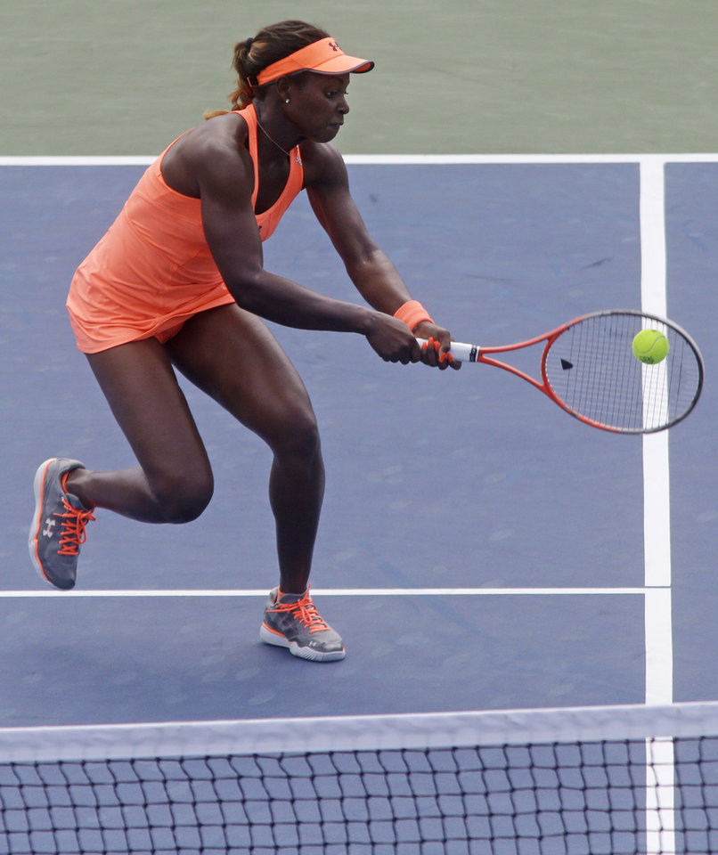 Photo - Sloane Stephens, of the United States, hits a backhand to Jelena Jankovic, from Serbia, at the Western & Southern Open tennis tournament, Thursday, Aug. 15, 2013, in Mason, Ohio. Jankovic won 3-6, 7-5, 7-5. (AP Photo/Al Behrman)