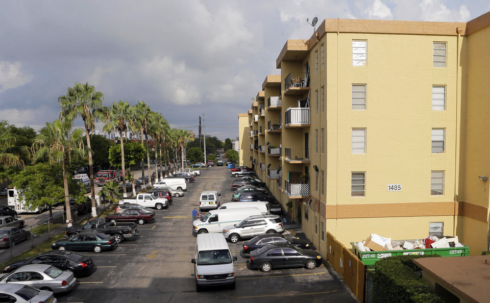 The apartment building where a fatal shooting took place is shown in Hialeah, Fla., Saturday, July 27, 2013. A gunman holding hostages inside the apartment complex killed six people before being shot to death by a SWAT team that stormed the building early Saturday following an hours-long standoff, police said. (AP Photo/Alan Diaz)