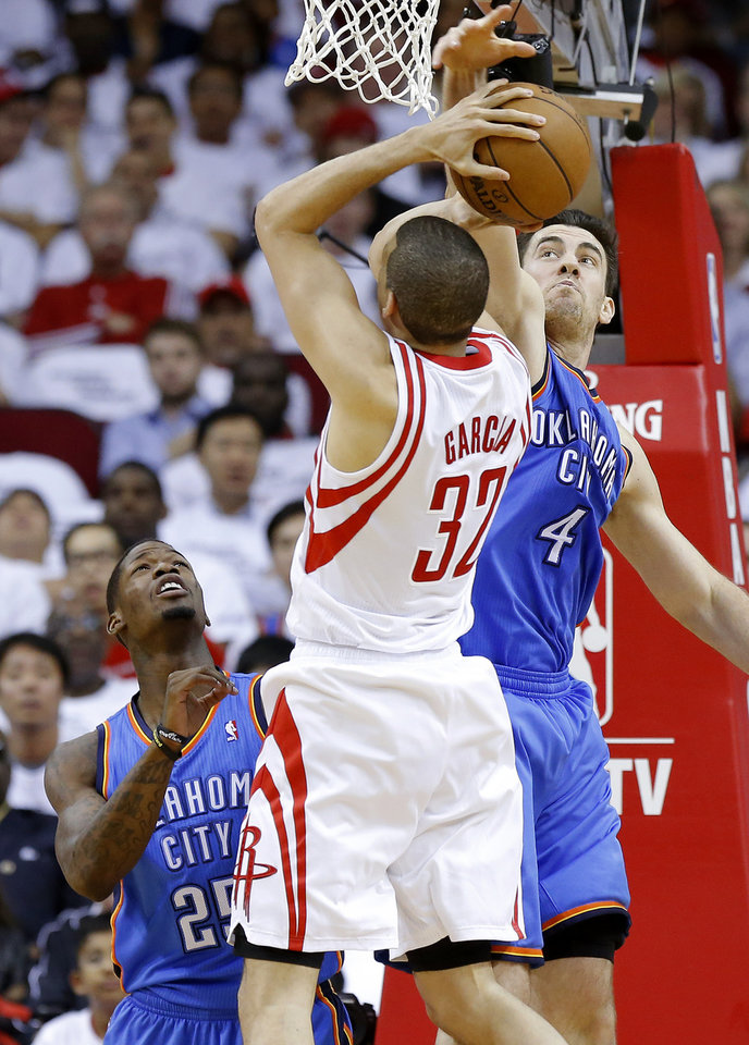 Oklahoma City\'s Nick Collison (4) and DeAndre Liggins (25) defend Houston\'s Francisco Garcia (32) during Game 3 in the first round of the NBA playoffs between the Oklahoma City Thunder and the Houston Rockets at the Toyota Center in Houston, Texas, Sat., April 27, 2013. Photo by Bryan Terry, The Oklahoman