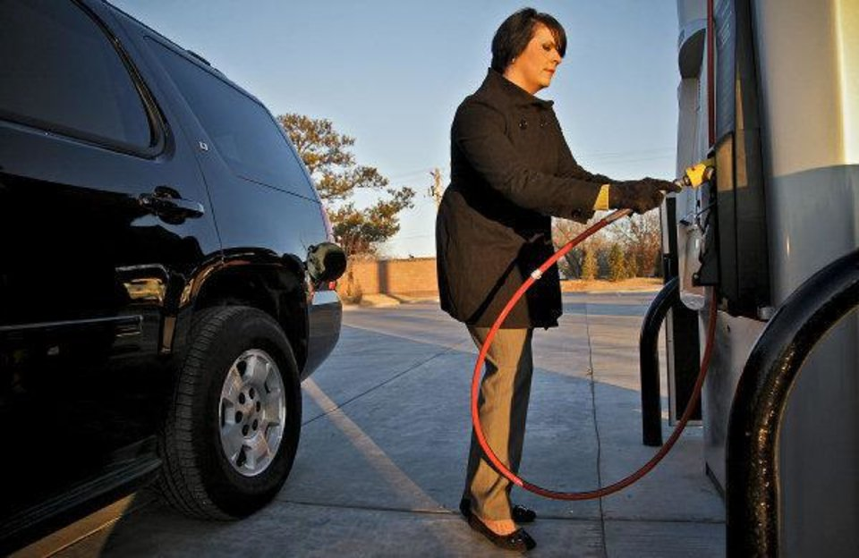 In this archive photo, Sundee Busby prepares to fill her Chevrolet Tahoe at a natural gas pump located at the OnCue Express on Jan. 11 in Edmond. <strong>CHRIS LANDSBERGER - CHRIS LANDSBERGER</strong>