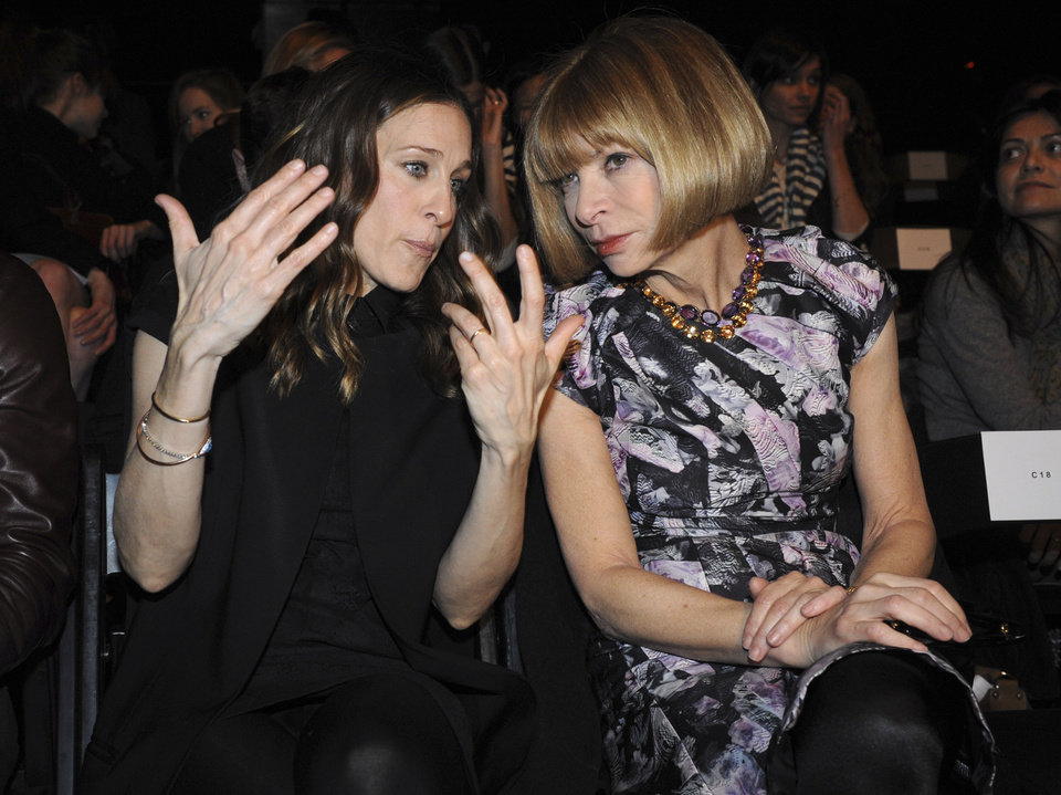 Sarah Jessica Parker and Anna Wintour converse on the runway before the showing of the fall 2009 collection of Alexander Wang during Fashion Week, Saturday, Feb. 14, 2009, in New York. (AP Photo/ Louis Lanzano)