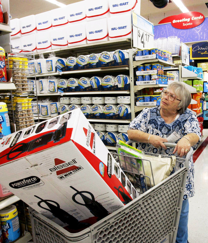 Nina Wilson shops at Walmart in Paramount, Calif. AP Photo