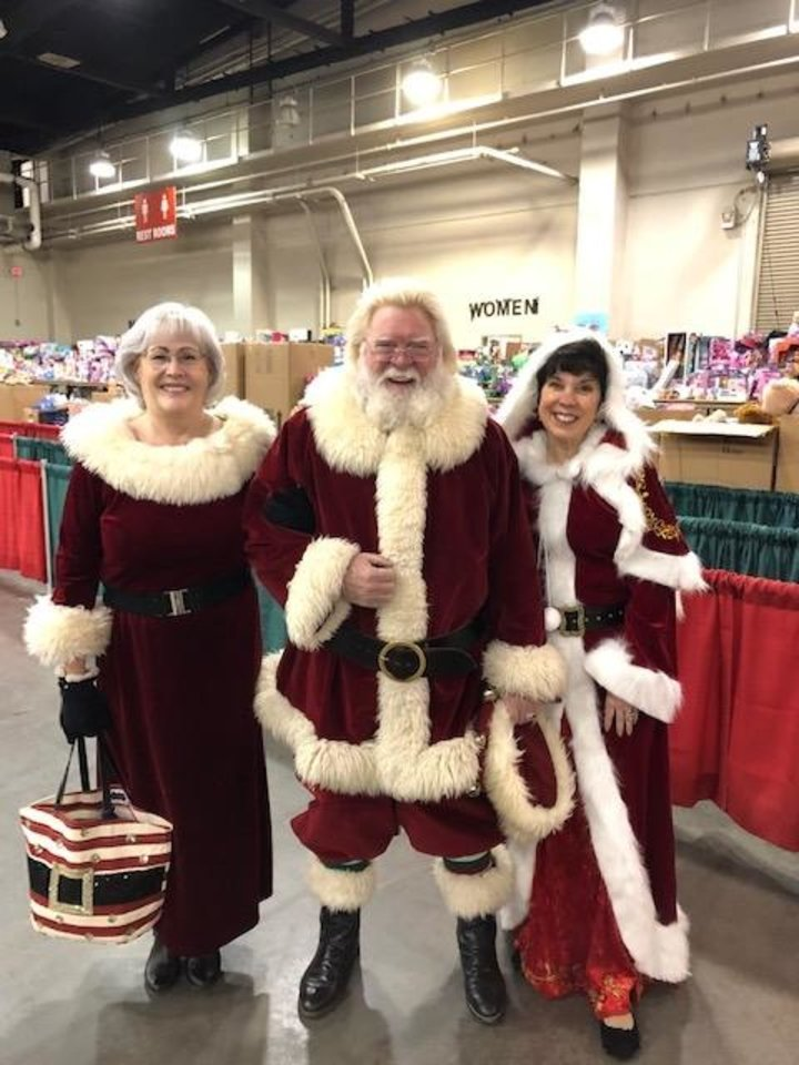 Photo -  Mr. and Mrs. Claus, portrayed by Larry and Daneta Blair, pose with Mary Blankenship Pointer, secretary/treasurer of the annual Red Andrews Christmas Dinner. [Photo provided.]