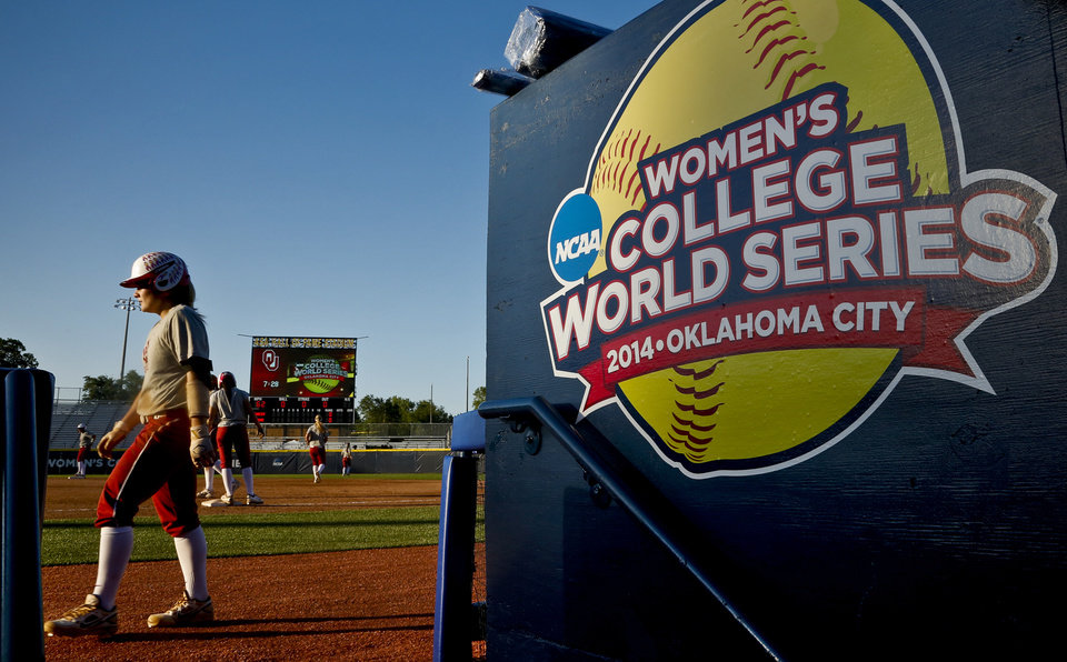 Photo - The Oklahoma softball team goes through practice during the Women's College World Series media day at ASA Hall of Fame Stadium on Wednesday, May 28, 2014 in Oklahoma City, Okla.  Photo by Chris Landsberger, The Oklahoman