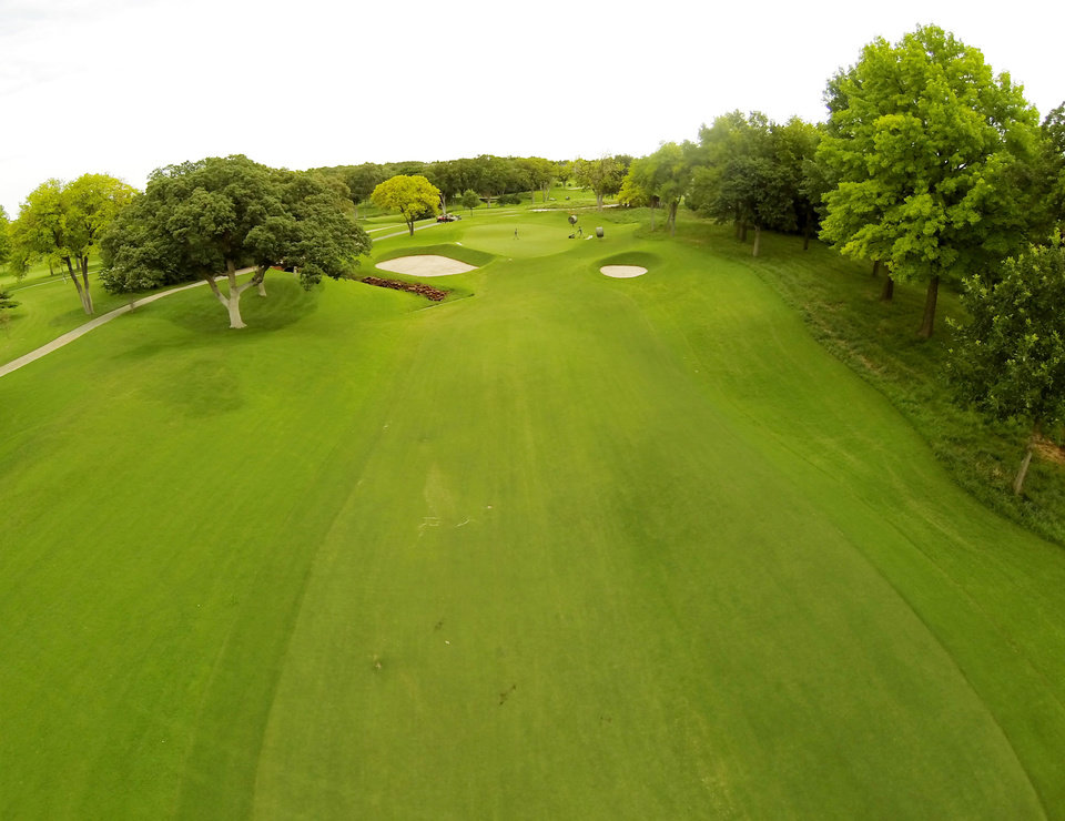 Photo - 5th green. Aerials of Oak Tree National course in Edmond, site of the 2014 U.S. Senior Open, Tuesday, July 1, 2014. Photo by Carl Shortt, Jr., for The Oklahoman