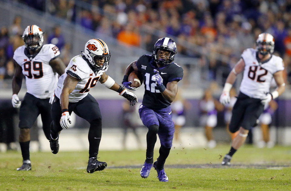 Photo -  TCU receiver Derius Davis (12) breaks away for a long catch and run during the second quarter against Oklahoma State on Saturday in Fort Worth, Texas. [AP PHOTO]