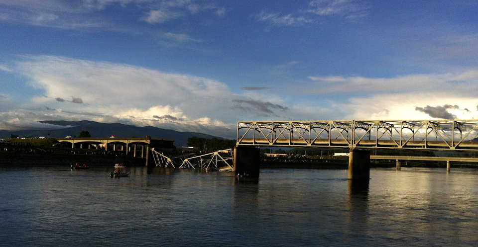 Photo - A portion of the Interstate 5 bridge is submerged after it collapsed into the Skagit River in Mount Vernon, Wash., Thursday, May 23, 2013. (AP Photo/The Seattle Times, Rick Lund)  TV OUT; USA TODAY OUT; MAGS OUT; NO SALES; SEATTLEPI.COM OUT; MANDATORY CREDIT