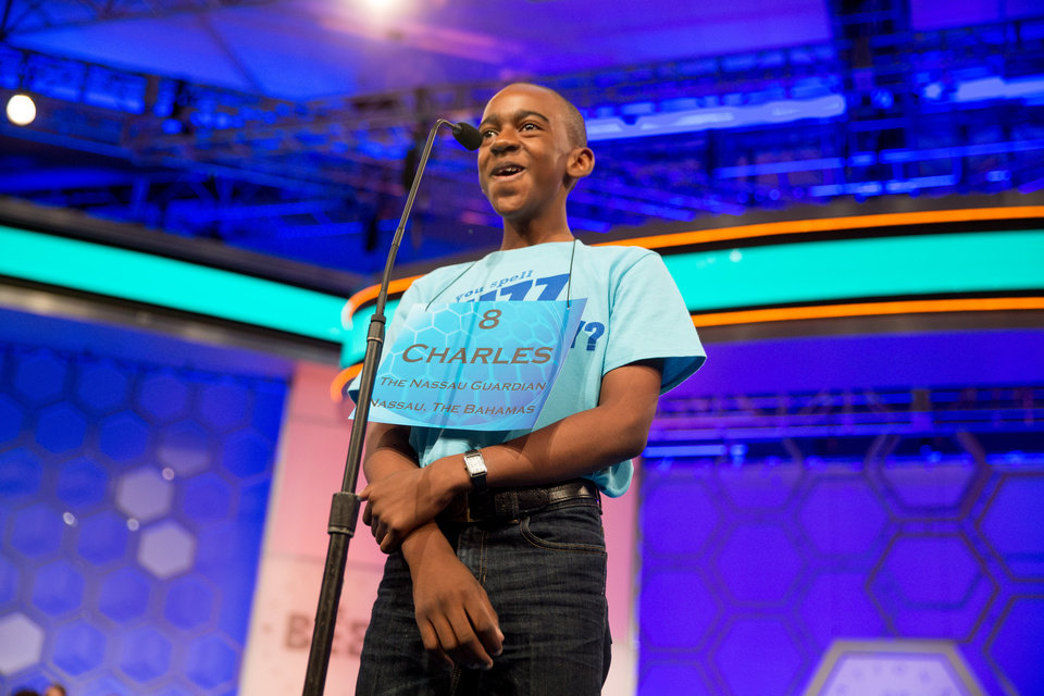 Photo - Charles Hamilton Jr., 12, of Nassau, Bahamas, smiles as he jokingly asks for an easier word to spell during the 2015 Scripps National Spelling Bee, Wednesday, May 27, 2015,  in Oxon Hill, Md. (AP Photo/Andrew Harnik)