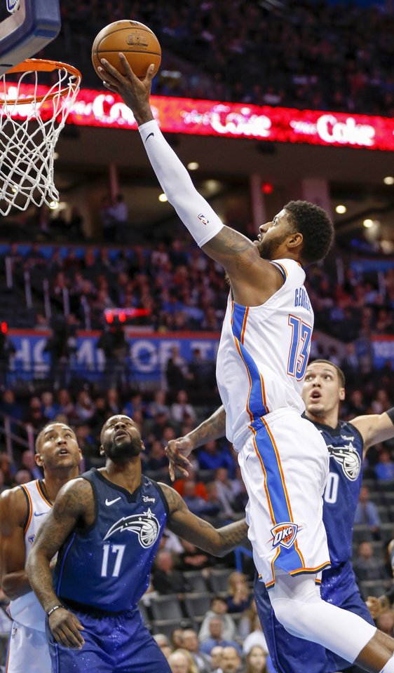 Photo - Oklahoma City's Paul George (13) takes the ball to the hoop during an NBA basketball game between the Oklahoma City Thunder and the Orlando Magic at Chesapeake Energy Arena in Oklahoma City, Monday, Feb. 26, 2018. Photo by Nate Billings, The Oklahoman
