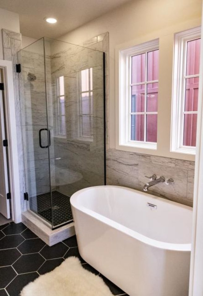 Photo -  Master bath at 1821 Runway Blvd., with three bedrooms, 2   baths, 2,384 square feet, offered for $539,500 by Wheeler Home. [CHRIS LANDSBERGER/THE OKLAHOMAN]
