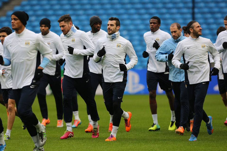 Photo - Manchester City's Alvaro Negredo, centre, trains with teammates at the Etihad Stadium, Manchester, England, Monday Feb. 17, 2014. Manchester City will play Barcelona on Tuesday in a Champions League first knock out round soccer match. (AP Photo/Jon Super)